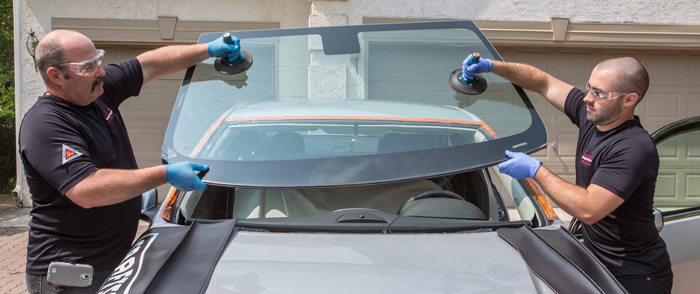 Auto glass repair technicians providing same day windshield replacement