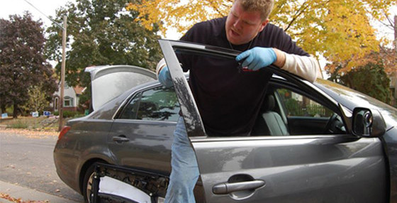 Man working on auto glass repair providing highest quality
