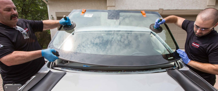 Auto Glass Repair Specialists Doing A Same Day Windshield Replacement